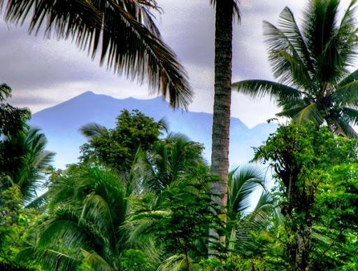 Mount Agung the holy mountain of Bali, as seen from the garden of Villa Sabandari, a botique hotel in Ubud, Bali